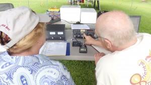 Bill KR4LO provides radio function instruction to event attendee, Joy McCracken.