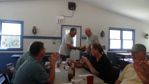 Mike KK4NLC who found the fox first is congratulated by club president Bill KR4LO