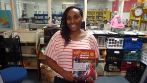 Ms. DaHonna Moore accepts the new Technician level manual for the Pamlico County Library